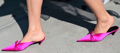 Walk with ultra violet mules...